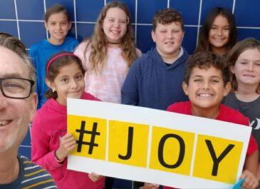Malcom fifth-grade teacher honored for 'giving joy'